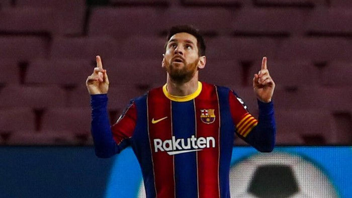Barcelonas Lionel Messi celebrates after scoring the opening goal during the Spanish La Liga soccer match between FC Barcelona and Elche at the Camp Nou stadium in Barcelona, Spain, Wednesday, Feb. 24, 2021. (AP Photo/Joan Monfort)