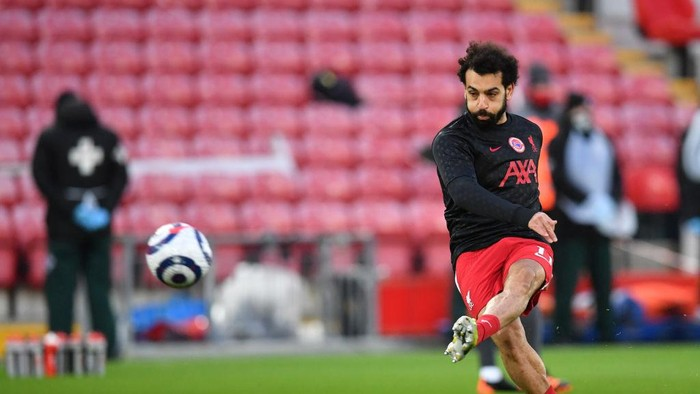LIVERPOOL, ENGLAND - FEBRUARY 20: Mohamed Salah of Liverpool warms up prior to the Premier League match between Liverpool and Everton at Anfield on February 20, 2021 in Liverpool, England. Sporting stadiums around the UK remain under strict restrictions due to the Coronavirus Pandemic as Government social distancing laws prohibit fans inside venues resulting in games being played behind closed doors. (Photo by Paul Ellis - Pool/Getty Images)