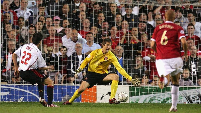 MANCHESTER, UNITED KINGDOM - APRIL 24:  Kaka of  AC Milan scores his teams second goal during the UEFA Champions League Semi Final, first leg match between Manchester United and AC Milan at Old Trafford on April 24, 2007 in Manchester, England.  (Photo by Laurence Griffiths/Getty Images)