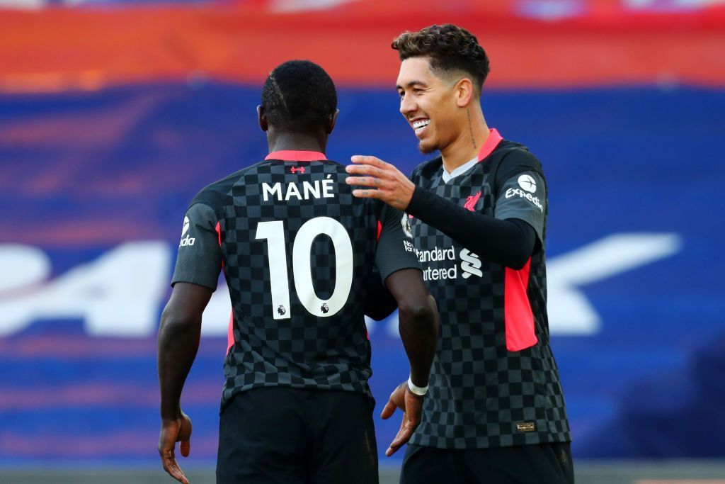LONDON, ENGLAND - SEPTEMBER 20: Sadio Mane of Liverpool celebrates with Roberto Firminho after scoring his team's first goal during the Premier League match between Chelsea and Liverpool at Stamford Bridge on September 20, 2020 in London, England. (Photo by Michael Regan/Getty Images)