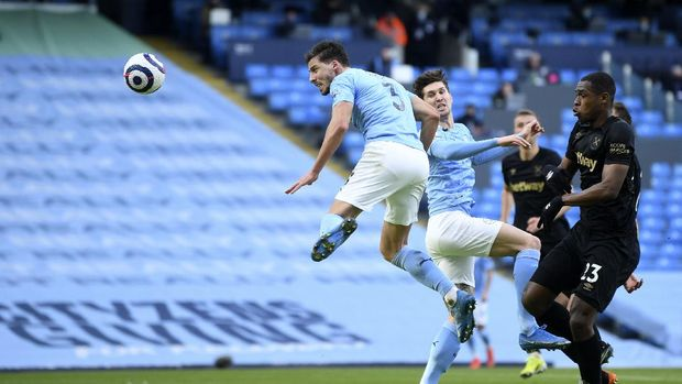 Manchester City's Ruben Dias, left, scores his side's opening goal during the English Premier League soccer match between Manchester City and West Ham United at the Etihad stadium in Manchester, England, Saturday, Feb. 27, 2021. (Gareth Copley/Pool via AP)