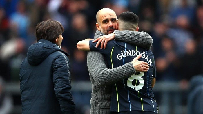 BURNLEY, ENGLAND - APRIL 28: Josep Guardiola, Manager of Manchester City celebrates victory with Ilkay Gundogan after the Premier League match between Burnley FC and Manchester City at Turf Moor on April 28, 2019 in Burnley, United Kingdom. (Photo by Clive Brunskill/Getty Images)