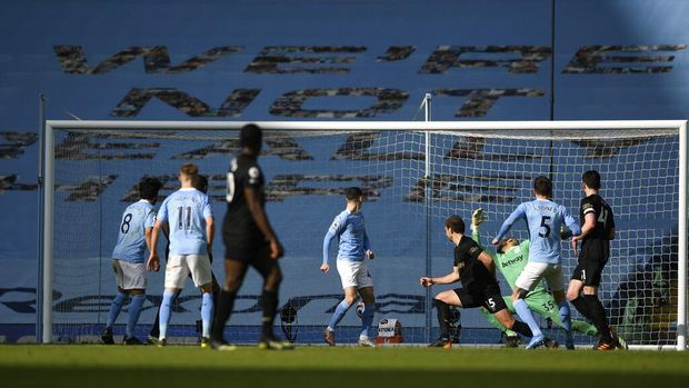 Manchester City's John Stones, second right, scores his side's second goal during the English Premier League soccer match between Manchester City and West Ham United at the Etihad stadium in Manchester, England, Saturday, Feb. 27, 2021. (Gareth Copley/Pool via AP)