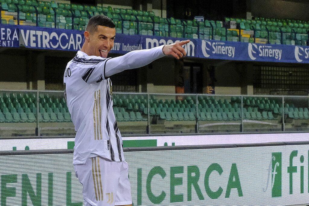 Cristiano Ronaldo celebrates his 0-1 goal during the Italian Serie A soccer match between Verona and Juventus at the Bentegodi stadium in Verona, Italy, on Saturday, Feb. 27, 2021. (Paola Garbuio/LaPresse via AP)
