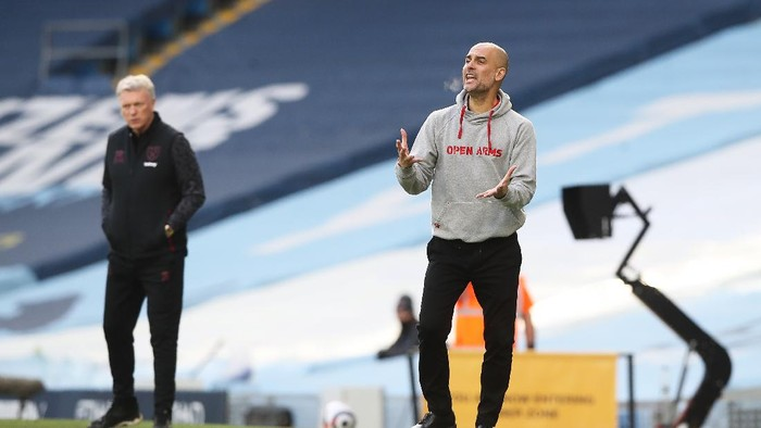 MANCHESTER, ENGLAND - FEBRUARY 27: Pep Guardiola, Manager of Manchester City reacts during the Premier League match between Manchester City and West Ham United at Etihad Stadium on February 27, 2021 in Manchester, England. Sporting stadiums around the UK remain under strict restrictions due to the Coronavirus Pandemic as Government social distancing laws prohibit fans inside venues resulting in games being played behind closed doors. (Photo by Martin Rickett - Pool/Getty Images)