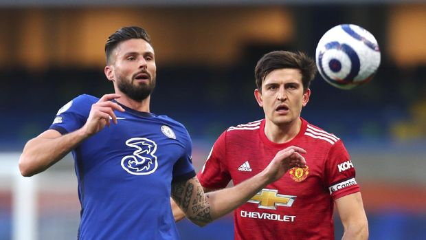 Chelsea's Olivier Giroud, left, and Manchester United's Harry Maguire challenge for the ball during the English Premier League soccer match between Chelsea and Manchester United at Stamford Bridge Stadium in London, England, Sunday, Feb. 28, 2021. (Clive Rose/Pool via AP)