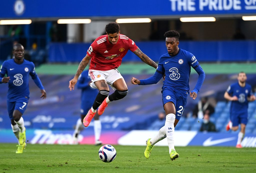 LONDON, ENGLAND - FEBRUARY 28: Marcus Rashford of Manchester United battles for possession with Callum Hudson-Odoi of Chelsea  during the Premier League match between Chelsea and Manchester United at Stamford Bridge on February 28, 2021 in London, England. Sporting stadiums around the UK remain under strict restrictions due to the Coronavirus Pandemic as Government social distancing laws prohibit fans inside venues resulting in games being played behind closed doors. (Photo by Andy Rain - Pool/Getty Images)