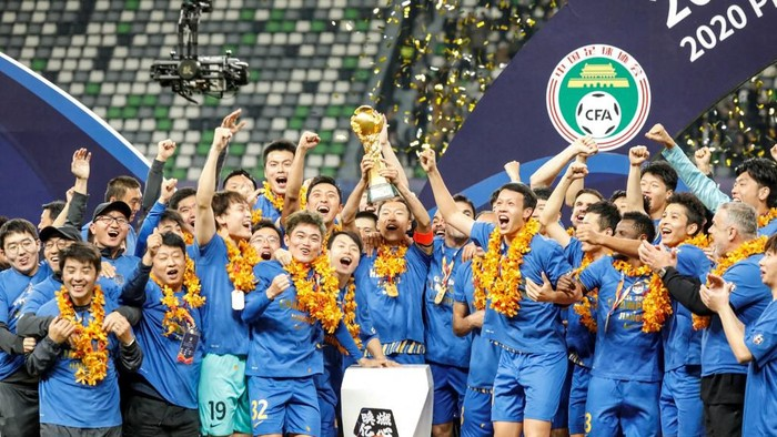 (FILES) This file photo taken on November 12, 2020 shows Jiangsu Suning players and staff members celebrating after their team defeated Guangzhou Evergrande to win the Chinese Super League (CSL) football championship in Suzhou, in Chinas eastern Jiangsu province. - The