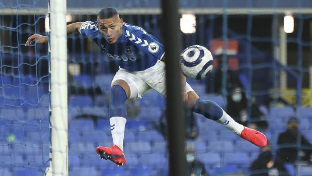 Everton's Richarlison scores his side's opening goal during the English Premier League soccer match between Everton and Southampton at Goodison Park in Liverpool, England, Monday, March 1, 2021. (Clive Brunskill/Pool via AP)