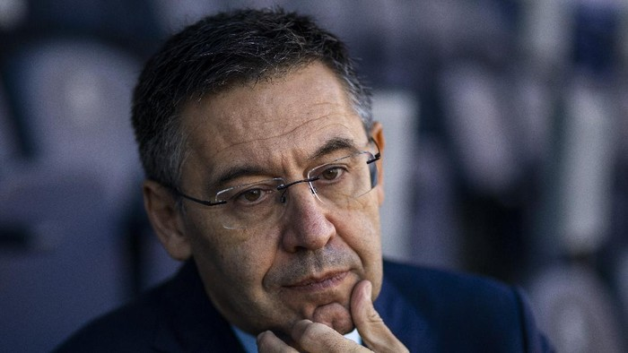 FILE - In this Nov. 8, 2019, file photo, President of FC Barcelona Josep Bartomeu pauses during and interview with the Associated Press at the Camp Nou stadium in Barcelona, Spain. Spanish police entered Barcelonas stadium on Monday March 1, 2021 and detained some people in a search and seize operation related to an investigation into club officials. The operation was related to last years Barçagate, in which club officials were accused of launching a smear campaign against current and former players who were critical of the club and then-president Josep Maria Bartomeu. (AP Photo/Emilio Morenatti, File)