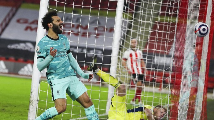 Liverpools Mohamed Salah screams after missing a chance to pass Sheffield Uniteds goalkeeper Aaron Ramsdale, right, and score during the English Premier League soccer match between Sheffield United and Liverpool at Bramall Lane stadium in Sheffield, England, Sunday, Feb. 28, 2021. (Lee Smith, Pool via AP)