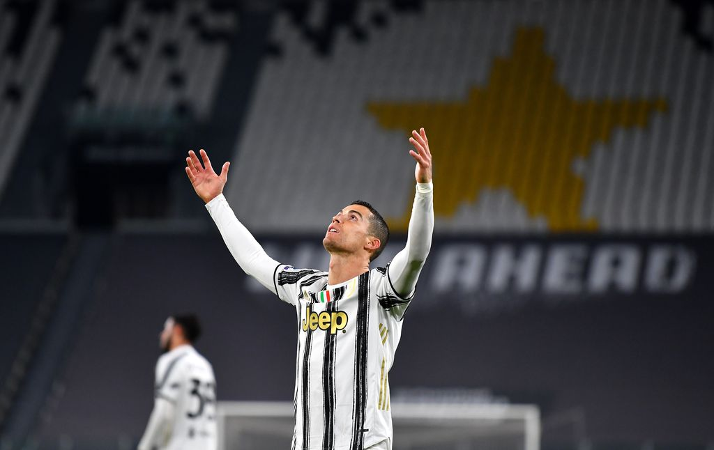 TURIN, ITALY - MARCH 02: Cristiano Ronaldo of Juventus reacts during the Serie A match between Juventus and Spezia Calcio at Allianz Stadium on March 02, 2021 in Turin, Italy. Sporting stadiums around the Italy remain under strict restrictions due to the Coronavirus Pandemic as Government social distancing laws prohibit fans inside venues resulting in games being played behind closed doors. (Photo by Valerio Pennicino/Getty Images)