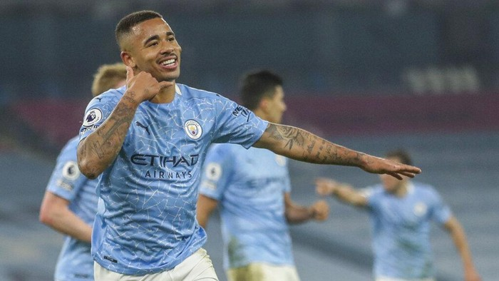 Manchester Citys Gabriel Jesus celebrates after scoring his team second goal during the English Premier League soccer match between Manchester City and Wolves at the Etihad stadium in Manchester, England, Tuesday, March 2, 2021. (Carl Recine/Pool via AP)
