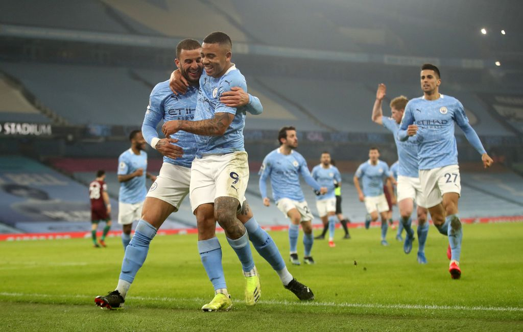 MANCHESTER, ENGLAND - MARCH 02: Gabriel Jesus of Manchester City celebrates with team mate Kyle Walker after scoring their side's second goal during the Premier League match between Manchester City and Wolverhampton Wanderers at Etihad Stadium on March 02, 2021 in Manchester, England. Sporting stadiums around the UK remain under strict restrictions due to the Coronavirus Pandemic as Government social distancing laws prohibit fans inside venues resulting in games being played behind closed doors. (Photo by Carl Recine - Pool/Getty Images)