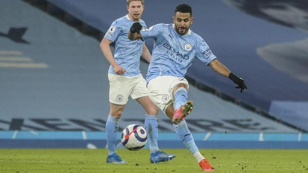 Manchester City's Riyad Mahrez scores his team third goal during the English Premier League soccer match between Manchester City and Wolves at the Etihad stadium in Manchester, England, Tuesday, March 2, 2021. (Carl Recine/Pool via AP)