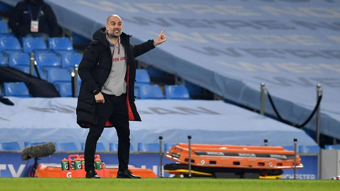 MANCHESTER, ENGLAND - MARCH 02: Pep Guardiola, Manager of Manchester City gives instructions to their side during the Premier League match between Manchester City and Wolverhampton Wanderers at Etihad Stadium on March 02, 2021 in Manchester, England. Sporting stadiums around the UK remain under strict restrictions due to the Coronavirus Pandemic as Government social distancing laws prohibit fans inside venues resulting in games being played behind closed doors. (Photo by Paul Ellis - Pool/Getty Images)