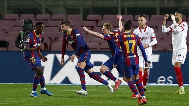 Barcelona's Gerard Pique, 2nd left, celebrates after scoring his side's second goal during the the Copa del Rey semifinal, second leg, soccer match between FC Barcelona and Sevilla FC at the Camp Nou stadium in Barcelona, Spain, Wednesday March 3, 2021. (AP Photo/Joan Monfort)