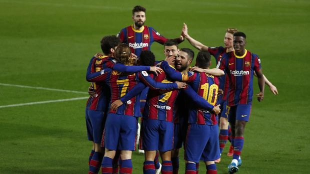 Barcelona players celebrate after scoring their third goal during the the Copa del Rey semifinal, second leg, soccer match between FC Barcelona and Sevilla FC at the Camp Nou stadium in Barcelona, Spain, Wednesday March 3, 2021. (AP Photo/Joan Monfort)