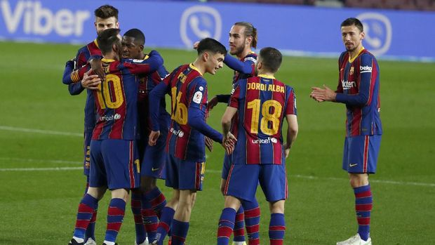 Barcelona's Ousmane Dembele, 3rd left, celebrates after scoring the opening goal during the the Copa del Rey semifinal, second leg, soccer match between FC Barcelona and Sevilla FC at the Camp Nou stadium in Barcelona, Spain, Wednesday March 3, 2021. (AP Photo/Joan Monfort)