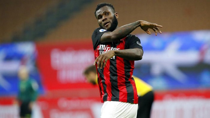 AC Milan midfielder Franck Kessie (79) reacts after scoring from the penalty spot during the Serie A soccer match between AC Milan and Udinese at the San Siro stadium, in Milan, Italy, Wednesday, March 3, 2021. (AP Photo/Antonio Calanni)
