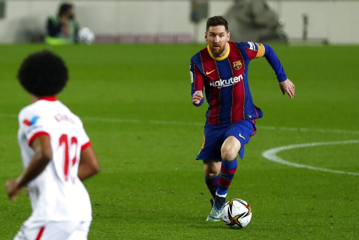 Barcelonas Lionel Messi runs with the ball during the the Copa del Rey semifinal, second leg, soccer match between FC Barcelona and Sevilla FC at the Camp Nou stadium in Barcelona, Spain, Wednesday March 3, 2021. (AP Photo/Joan Monfort)