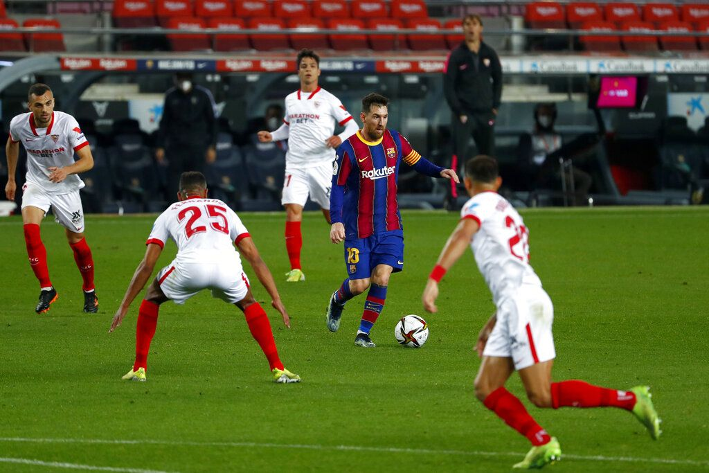 Barcelona's Lionel Messi runs with the ball during the the Copa del Rey semifinal, second leg, soccer match between FC Barcelona and Sevilla FC at the Camp Nou stadium in Barcelona, Spain, Wednesday March 3, 2021. (AP Photo/Joan Monfort)