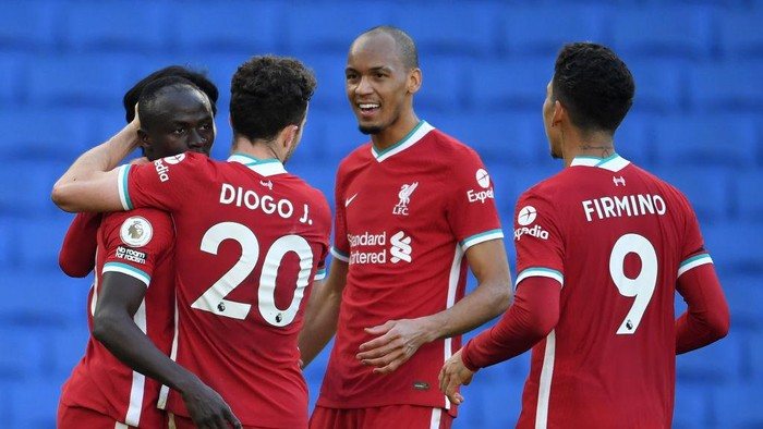 BRIGHTON, ENGLAND - NOVEMBER 28: Sadio Mane of Liverpool celebrates with teammates Diogo Jota, Fabinho, and Roberto Firminho after scoring a goal which was then disallowed during the Premier League match between Brighton & Hove Albion and Liverpool at American Express Community Stadium on November 28, 2020 in Brighton, England. Sporting stadiums around the UK remain under strict restrictions due to the Coronavirus Pandemic as Government social distancing laws prohibit fans inside venues resulting in games being played behind closed doors. (Photo by Mike Hewitt/Getty Images)