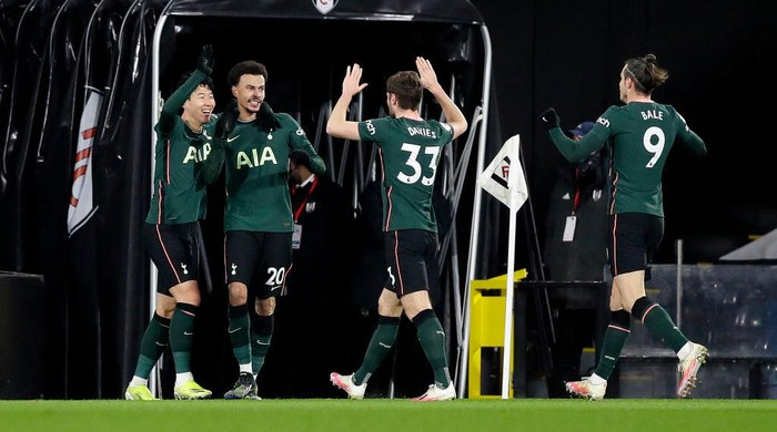 LONDON, ENGLAND - MARCH 04: Dele Alli of Tottenham Hotspur celebrates with teammates Son Heung-Min, Ben Davies, and Gareth Bale after scoring his teams first goal during the Premier League match between Fulham and Tottenham Hotspur at Craven Cottage on March 04, 2021 in London, England. Sporting stadiums around the UK remain under strict restrictions due to the Coronavirus Pandemic as Government social distancing laws prohibit fans inside venues resulting in games being played behind closed doors. (Photo by Kirsty Wigglesworth - Pool/Getty Images)
