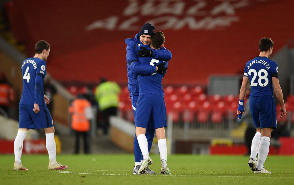 LIVERPOOL, ENGLAND - MARCH 04: Thomas Tuchel, Manager of Chelsea celebrates with Jorginho of Chelsea following victory in the Premier League match between Liverpool and Chelsea at Anfield on March 04, 2021 in Liverpool, England. Sporting stadiums around the UK remain under strict restrictions due to the Coronavirus Pandemic as Government social distancing laws prohibit fans inside venues resulting in games being played behind closed doors. (Photo by Oli Scarff - Pool/Getty Images)