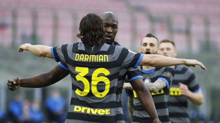 Inter Milans Matteo Darmian, left, celebrates with his teammate Inter Milans Romelu Lukaku after scoring his sides second goal during a Serie A soccer match between Inter Milan and Genoa at the San Siro stadium in Milan, Italy, Sunday, Feb. 28, 2021. (AP Photo/Luca Bruno)