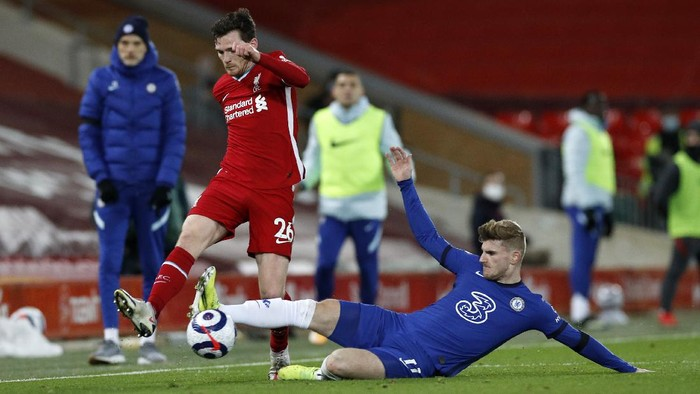 LIVERPOOL, ENGLAND - MARCH 04: Andy Robertson of Liverpool is challenged by Timo Werner of Chelsea during the Premier League match between Liverpool and Chelsea at Anfield on March 04, 2021 in Liverpool, England. Sporting stadiums around the UK remain under strict restrictions due to the Coronavirus Pandemic as Government social distancing laws prohibit fans inside venues resulting in games being played behind closed doors. (Photo by Phil Noble - Pool/Getty Images)