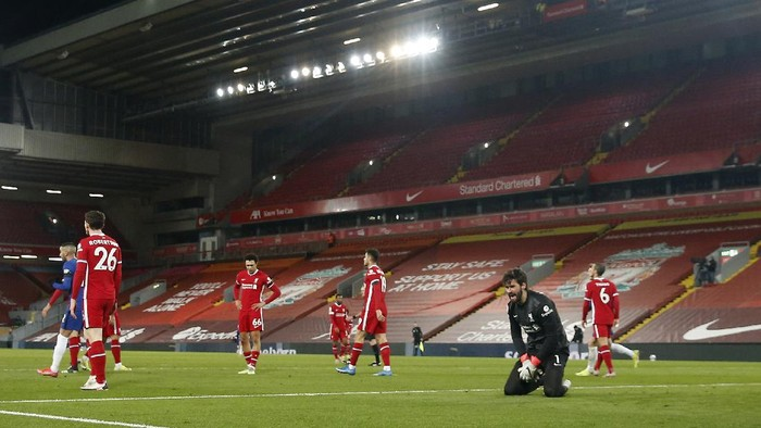 Liverpools goalkeeper Alisson, second from right, reacts after Chelseas Mason Mount scored during the English Premier League soccer match between Liverpool and Chelsea at Anfield stadium in Liverpool, England, Thursday, March 4, 2021. (Phil Noble, Pool via AP)