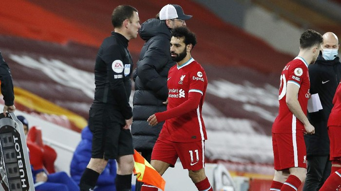 Liverpools Mohamed Salah, center, leaves the pitch during the English Premier League soccer match between Liverpool and Chelsea at Anfield stadium in Liverpool, England, Thursday, March 4, 2021. (Phil Noble, Pool via AP)