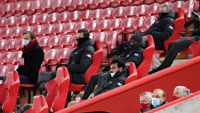 LIVERPOOL, ENGLAND - MARCH 04: Mohamed Salah of Liverpool looks on from the bench after being substituted off during the Premier League match between Liverpool and Chelsea at Anfield on March 04, 2021 in Liverpool, England. Sporting stadiums around the UK remain under strict restrictions due to the Coronavirus Pandemic as Government social distancing laws prohibit fans inside venues resulting in games being played behind closed doors. (Photo by Laurence Griffiths/Getty Images)
