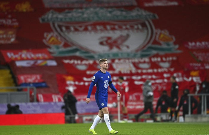 Chelseas Timo Werner walks during the English Premier League soccer match between Liverpool and Chelsea at Anfield stadium in Liverpool, England, Thursday, March 4, 2021. (Laurence Griffiths, Pool via AP)