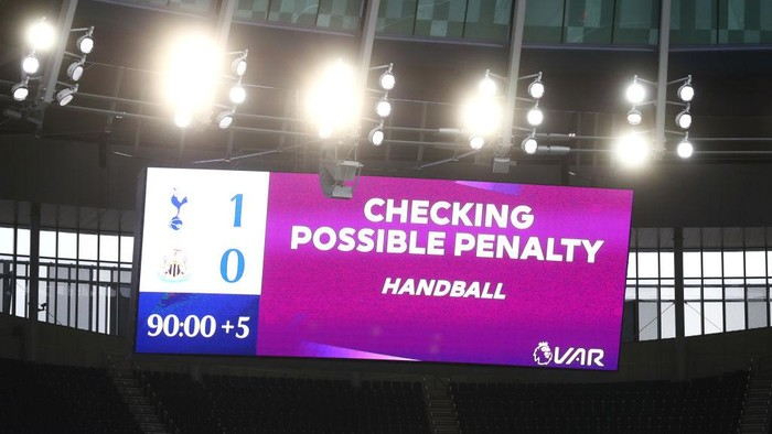 LONDON, ENGLAND - SEPTEMBER 27: The LED screen inside the stadium displays a sign informing about a VAR review for handball during the Premier League match between Tottenham Hotspur and Newcastle United at Tottenham Hotspur Stadium on September 27, 2020 in London, England. Sporting stadiums around the UK remain under strict restrictions due to the Coronavirus Pandemic as Government social distancing laws prohibit fans inside venues resulting in games being played behind closed doors. (Photo by Clive Rose/Getty Images)