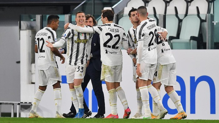 TURIN, ITALY - MARCH 02: Alvaro Morata of Juventus celebrates with team mates Merih Demiral and Dejan Kulusevski after scoring their sides first goal during the Serie A match between Juventus and Spezia Calcio at Allianz Stadium on March 02, 2021 in Turin, Italy. Sporting stadiums around the Italy remain under strict restrictions due to the Coronavirus Pandemic as Government social distancing laws prohibit fans inside venues resulting in games being played behind closed doors. (Photo by Valerio Pennicino/Getty Images)