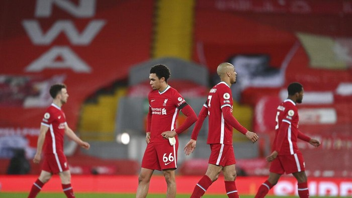 Liverpools players stand at the end of the English Premier League soccer match between Liverpool and Chelsea at Anfield stadium in Liverpool, England, Thursday, March 4, 2021. Chelsea won 1-0. (Laurence Griffiths, Pool via AP)