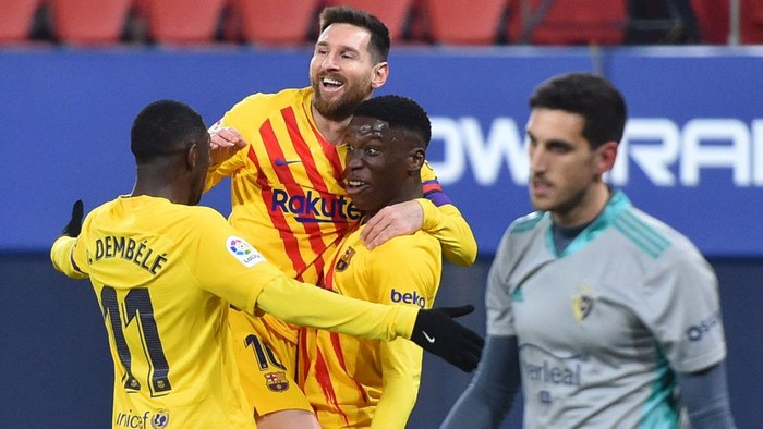 PAMPLONA, SPAIN - MARCH 06: Ilaix Moriba of FC Barcelona  celebrates with Lionel Messi and Ousmane Dembele  after scoring their teams second goal  during the La Liga Santander match between C.A. Osasuna and FC Barcelona at Estadio El Sadar on March 06, 2021 in Pamplona, Spain. Sporting stadiums around Spain remain under strict restrictions due to the Coronavirus Pandemic as Government social distancing laws prohibit fans inside venues resulting in games being played behind closed doors.  (Photo by Juan Manuel Serrano Arce/Getty Images)