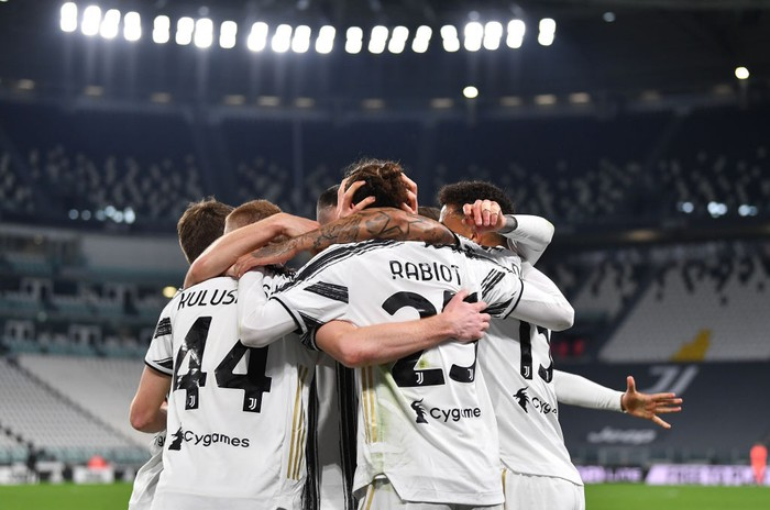 TURIN, ITALY - MARCH 06: Adrien Rabiot of Juventus celebrates with teammates after scoring their teams first goal  during the Serie A match between Juventus  and SS Lazio at Allianz Stadium on March 06, 2021 in Turin, Italy. Sporting stadiums around Italy remain under strict restrictions due to the Coronavirus Pandemic as Government social distancing laws prohibit fans inside venues resulting in games being played behind closed doors. (Photo by Valerio Pennicino/Getty Images)