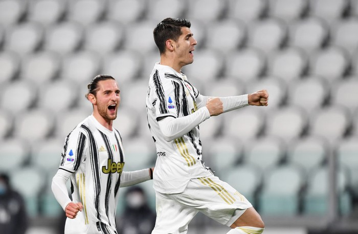 TURIN, ITALY - MARCH 06: Alvaro Morata of Juventus  celebrates with Adrien Rabiot  after scoring their teams third goal from the penalty spot during the Serie A match between Juventus  and SS Lazio at Allianz Stadium on March 06, 2021 in Turin, Italy. Sporting stadiums around Italy remain under strict restrictions due to the Coronavirus Pandemic as Government social distancing laws prohibit fans inside venues resulting in games being played behind closed doors. (Photo by Valerio Pennicino/Getty Images)