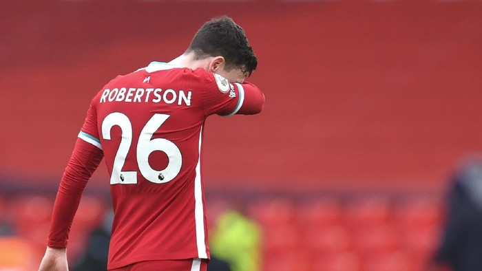 Liverpools Andrew Robertson reacts disappointed after the English Premier League soccer match between Liverpool and Fulham at Anfield stadium in Liverpool, England, Sunday, March 7, 2021. (Paul Ellis/Pool via AP)