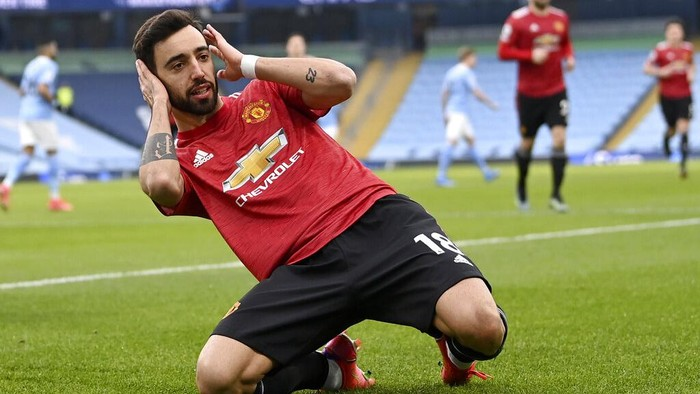 Manchester Uniteds Bruno Fernandes celebrates after scoring the opening goal during the English Premier League soccer match between Manchester City and Manchester United at the Etihad Stadium in Manchester, England, Sunday, March 7, 2021. (Laurence Griffiths/Pool via AP)