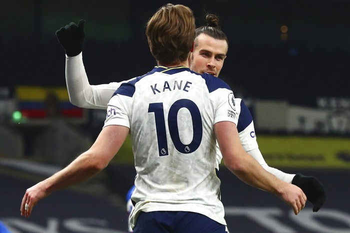 Tottenhams Gareth Bale, right, celebrates after scoring his sides opening goal with Tottenhams Harry Kane during the English Premier League soccer match between Tottenham Hotspur and Crystal Palace at the Tottenham Hotspur Stadium in London, Sunday, March 7, 2021. (Clive Rose/Pool via AP)