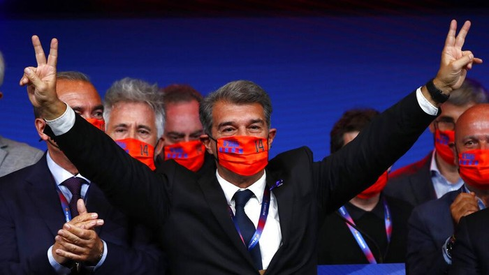 Joan Laporta celebrates his victory after elections at the Camp Nou stadium in Barcelona, Spain, Sunday, March 7, 2021. Joan Laporta has been elected Barcelonas president on Sunday, inheriting a club mired in debt and facing daunting problems that include the possible departure of Messi when his contract ends at the end of the season. (AP Photo/Joan Monfort)