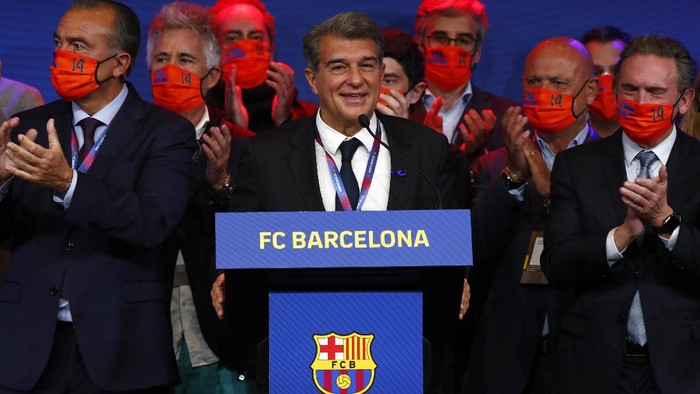Joan Laporta, centre, celebrates his victory after elections at the Camp Nou stadium in Barcelona, Spain, Sunday, March 7, 2021. Joan Laporta has been elected Barcelonas president on Sunday, inheriting a club mired in debt and facing daunting problems that include the possible departure of Messi when his contract ends at the end of the season. (AP Photo/Joan Monfort)