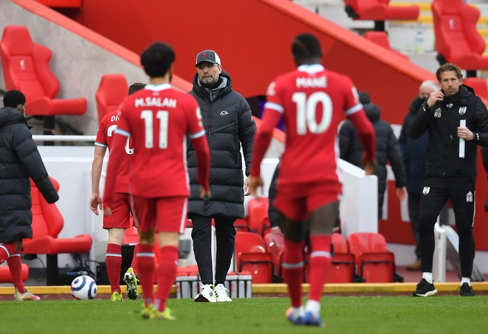 LIVERPOOL, ENGLAND - MARCH 07: Jurgen Klopp, Manager of Liverpool looks on as Mohamed Salah and Sadio Mane of Liverpool leave the pitch following the Premier League match between Liverpool and Fulham at Anfield on March 07, 2021 in Liverpool, England. Sporting stadiums around the UK remain under strict restrictions due to the Coronavirus Pandemic as Government social distancing laws prohibit fans inside venues resulting in games being played behind closed doors. (Photo by Paul Ellis - Pool/Getty Images)