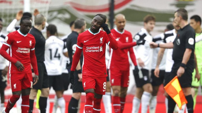 Liverpools Naby Keita reacts after the English Premier League soccer match between Liverpool and Fulham at Anfield stadium in Liverpool, England, Sunday, March 7, 2021. (Clive Brunskill/Pool via AP)