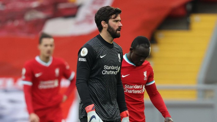 LIVERPOOL, ENGLAND - MARCH 07: Alisson Becker of Liverpool looks dejected following the Premier League match between Liverpool and Fulham at Anfield on March 07, 2021 in Liverpool, England. Sporting stadiums around the UK remain under strict restrictions due to the Coronavirus Pandemic as Government social distancing laws prohibit fans inside venues resulting in games being played behind closed doors. (Photo by Clive Brunskill/Getty Images)