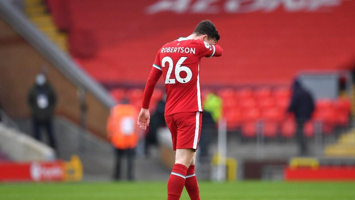 LIVERPOOL, ENGLAND - MARCH 07: Andy Robertson of Liverpool looks dejected following the Premier League match between Liverpool and Fulham at Anfield on March 07, 2021 in Liverpool, England. Sporting stadiums around the UK remain under strict restrictions due to the Coronavirus Pandemic as Government social distancing laws prohibit fans inside venues resulting in games being played behind closed doors. (Photo by Paul Ellis - Pool/Getty Images)